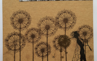 Glue one of the collaged dandelion strips alongside the pencil line,  and the second above the dandelions with a strip of gold card.  Stamp 'Embrace your Dreams' and cut out these words, attaching to the book where shown.
