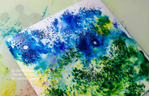 Sprinkle blue Brusho inks at the top of the paper and greens below.