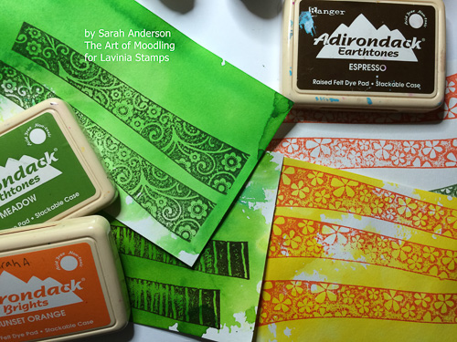 Stamp the Hill Border stamps on these papers using the Adirondack ink pads.