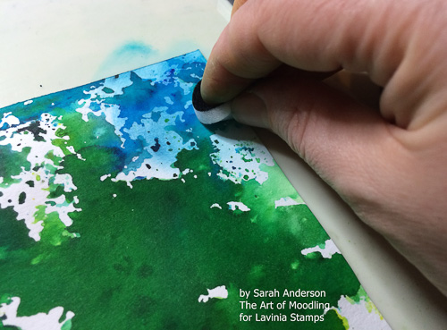 Use the blending foam to fill the white space on the square of paper with the distress inks.
