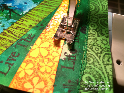 Use green thread in your sewing machine and stitch along the edges of the 'hills'. Your stitching doesn't need to be perfect, wonky stitches add to the effect! I stitched over each line a couple of times.