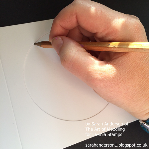 2 Cut a piece of card the size of the front of the card. Place it behind the the aperture and mark the position of the circular hole.