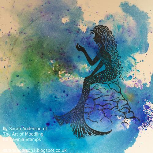 7 Stamp the mermaid using Onyx Black ink.
